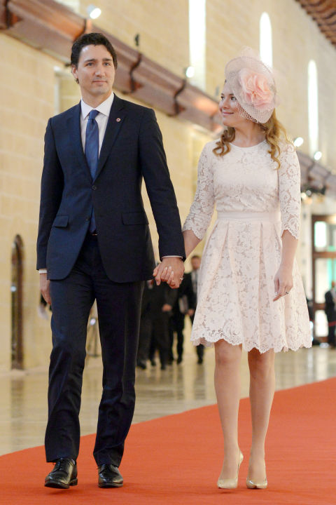 Walking hand in hand to the ceremony of the Commonwealth Heads of Government Meeting in Valletta, Canada