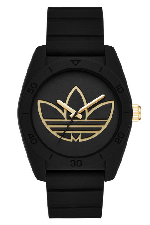 A black-on-black timepiece is the perfect gift for a stylish guy.  Santiago Black Silicone Three-Hand Watch Adidas Originals, $75, Watch Station
