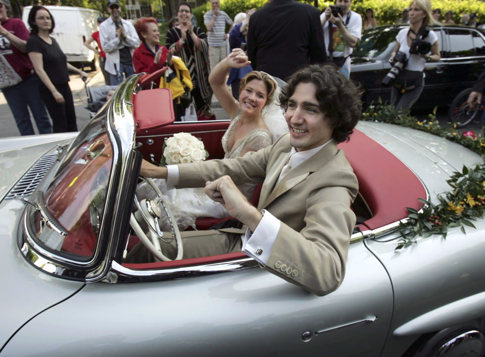 Leaving their wedding ceremony at theSainte-Madeleine D'Outremont Church inMontreal, Canada